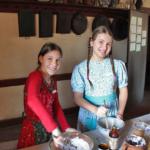 girls baking a cake