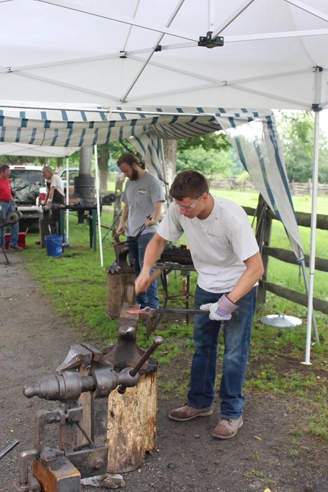 blacksmithing students