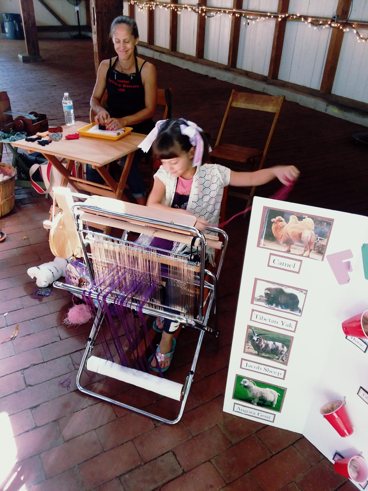 girl weaving at Wool Frolic event