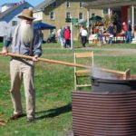 Stiffing apple butter at Harvest Days